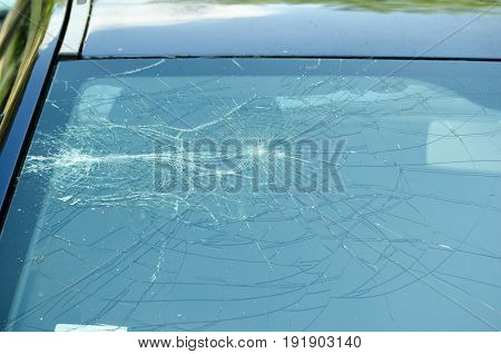 Broken car windshield. Cracked windshield. Crushed windshield. Damaged car. Broken car. Car crash.