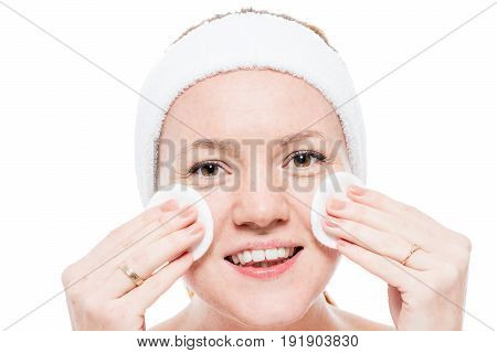 Female Face With Freckles And Cleansing Cotton Pads Close-up Isolated