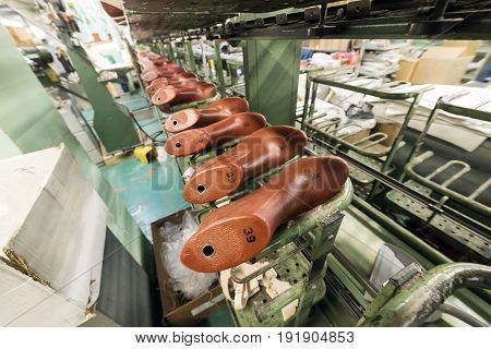 The conveyor with shoe lasts. Shoe factory, mass production of footwear.