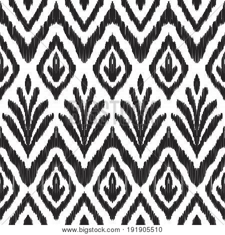 Ikat seamless pattern. Fancy textile design. Vector illustration in white and black colors. Tapestry print in ethnic style.