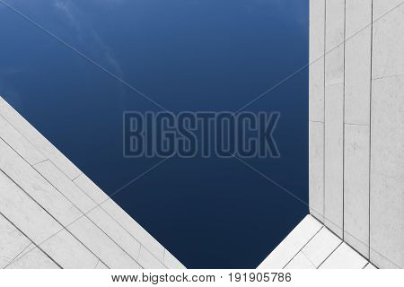 Clear blue sky over a modern industrial building
