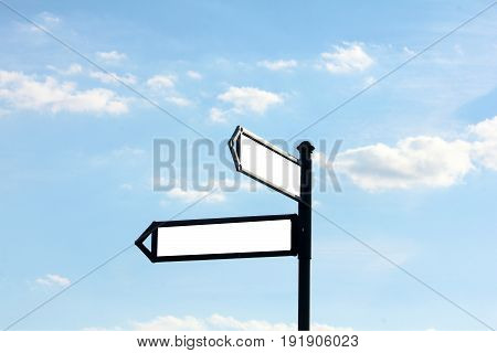 Signpost against the blue sky, blank area text