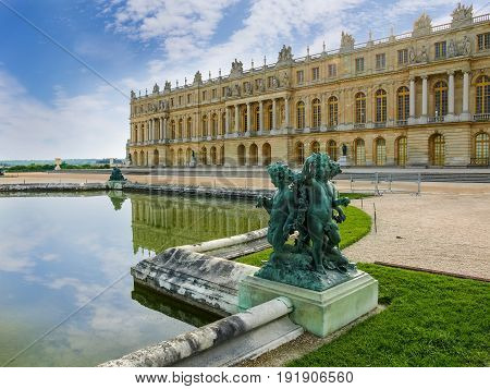Part of a northwest facade of the Central gallery of the Palace of Versailles with Water Parterre and sculpture