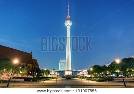 BERLIN -AUGUST 18 2015: Alexanderplatz at night on OAugust 18 2015 in Berlin Germany. It's a large public square and transport hub in the central Mitte district of Berlin near the Fernsehturm.