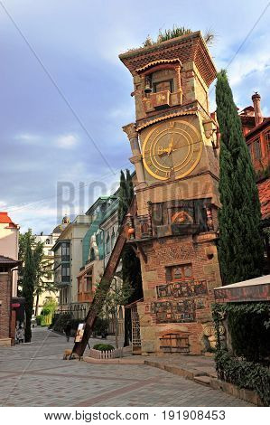 TBILISI GEORGIA - SEPTEMBER 28: Tower with a clock in the city centre of Tbilisi on September 28 2016. Tbilisi is a capital and largest city of Georgia.