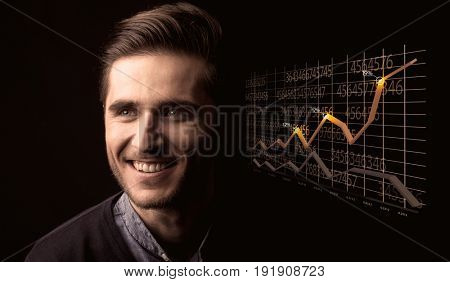 Elegant Businessman with Line Graphs and Statistics