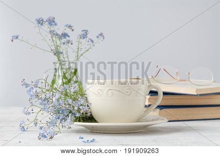 Forget-me-nots Flowers On Book, On Wooden Background