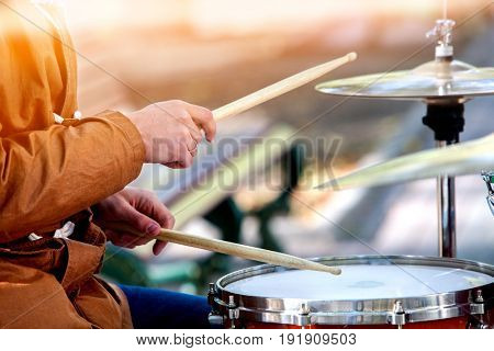 Music street performers on autumn outdoor. Middle section of body part. Body part hands give concerts for people. Color tone on shiny sunlight background.