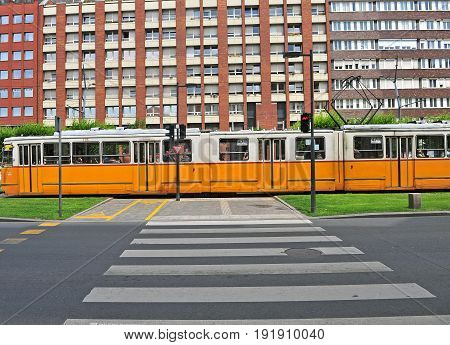 BUDAPEST HUNGARY - JUNE 4: Yellow tram in the street of Budapest downtown on June 4 2016.