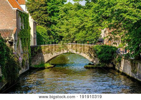 Bruges (Brugge) cityscape with water canal and bridge, Flanders, Belgium