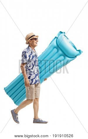 Full length profile shot of a senior with an air mattress walking isolated on white background