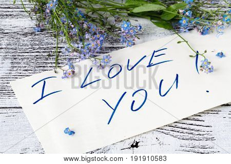 Forget me not flower on and love note