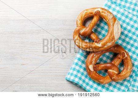 Pretzel. Beer snacks on wooden table. Top view with copy space