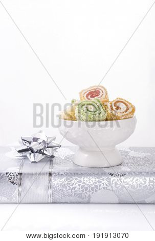Close up of Mediterranean sweet placed over a silver gift box. Isolated image. Sweet and gift pack.