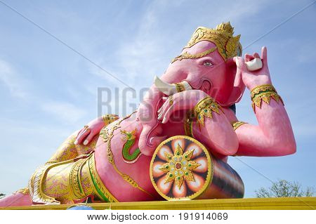 close up pink ganesh statue on blue sky