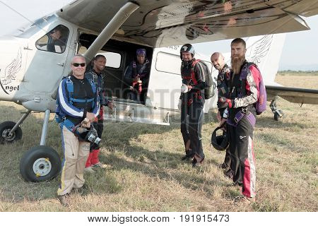 White And Black Skydivers Mounting A X328 Atlas Angel Turbine Specially Equipped Aircraft For Skydiv