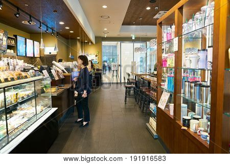 SEOUL, SOUTH KOREA - CIRCA MAY, 2017: goods on display at Starbucks in Seoul. Starbucks Corporation is an American coffee company and coffeehouse chain.