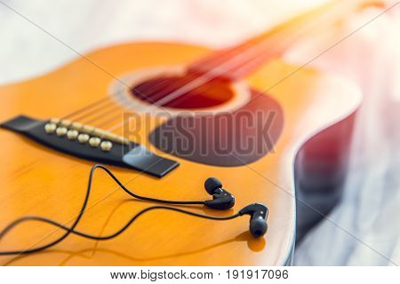 Listening And Play The Music With Guitar, Relax Happy Time With Song Concept. Closeup Wood Folk Guit