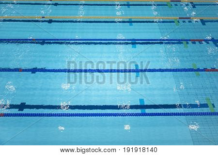 Sport swimming pool inside building as background