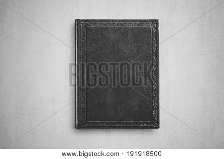 book on grey background close up view from above black and white photo
