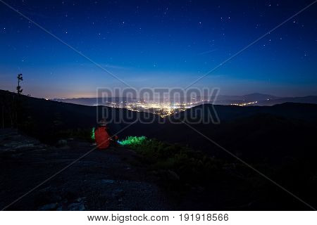 Alone Man Tourist Hiker Looking On City Lights