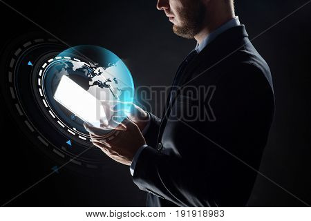 business, people, mass media and future technology concept - close up of businessman with transparent tablet pc computer and virtual earth virtual projection over black background