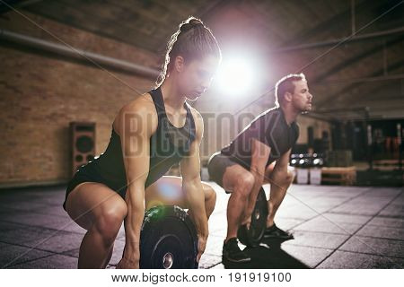 Two Strong People Training With Weight Disks