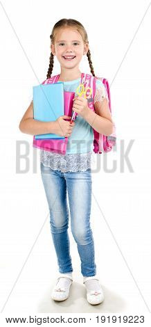 Portrait of smiling school girl child with backpack and books isolated on a white background