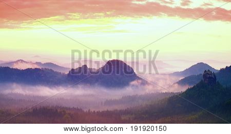 Red Misty  Landscape Panorama In Mountains. Fantastic Dreamy Sunrise On Rocky Mountains.  Foggy Mist