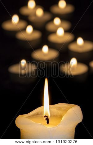 Golden candlelight over black background.