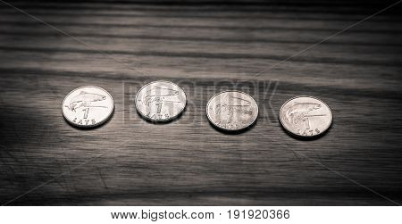 Old Latvian coins on a wooden backgrouns. Lats and centimes.