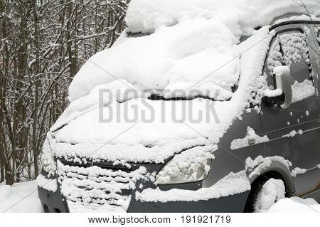 Abandoned bus trapped in snow outdoor cropped photo