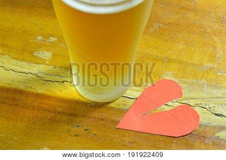 broken heart and glass of beer for healing hurt feeling