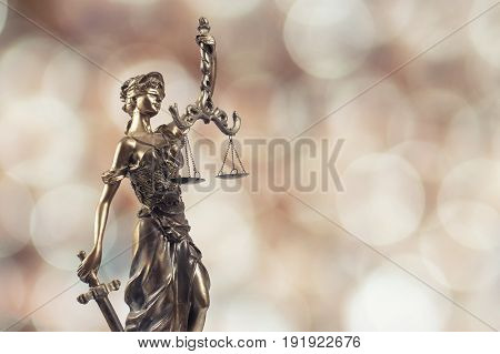 Statue of justice on Bokeh background.Law Symbol.
