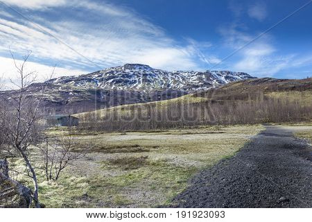 Icelandic volcanic landscape with blue sky in spring
