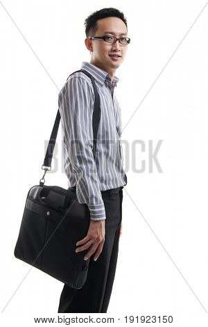 Young Asian man with laptop bag standing isolated on white background