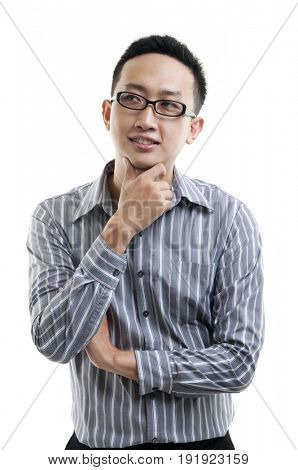 Asian male hand on chin having a thought, standing isolated on white background.