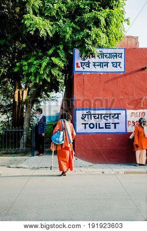 KURUKSHETRA HARYANA INDIA : 19 JUNE 2016 - portrait of an Indian sadhu (holy man) entering a toilet premises