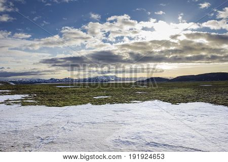 Snow rest in front of icelandic volcanic landscape