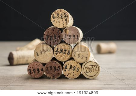Close up shot of a stack of dated wine bottle corks