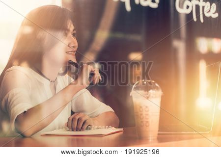 Asian Women Smile Enjoy Woking At The Cafe With Laptop. Thinking Business Project Action.