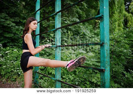 Sport Girl At Sportswear Exercising At Horizontal Bar Exercises In A Green Park And Training At Natu
