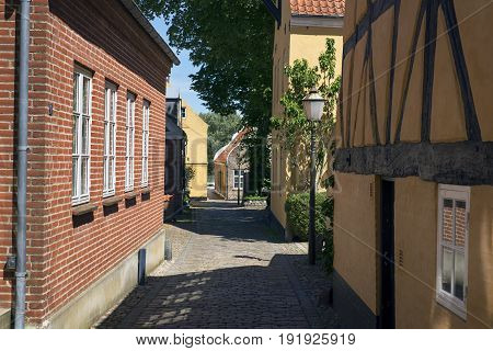 Narrow street with old houses from royal town Ribe in Denmark