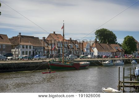 RIBE DENMARK - JUNE 17 2017: Harbour old houses vintage cars and kayak in river in royal town Ribe Denmark