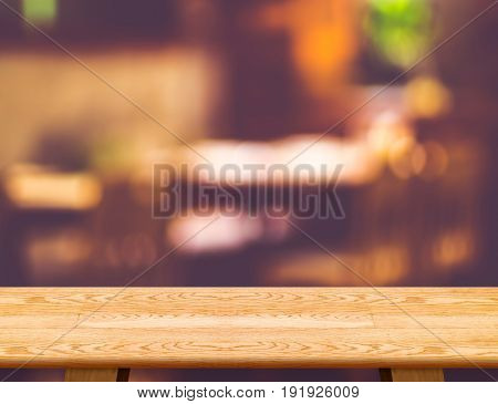 Empty Wooden Table And Blurred Cafe Bokeh Light Background. Mock Up For Display Or Montage Of Produc