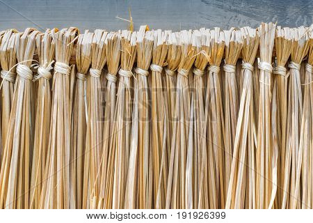 bind down of yellow straw texture background.