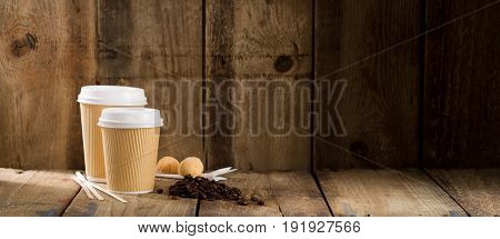 Ribbed Paper Cups Alongside Coffee Beans And Pastry Copy Space