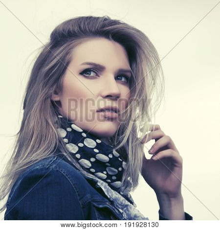 Young fashion blond woman in denim jacket outdoor