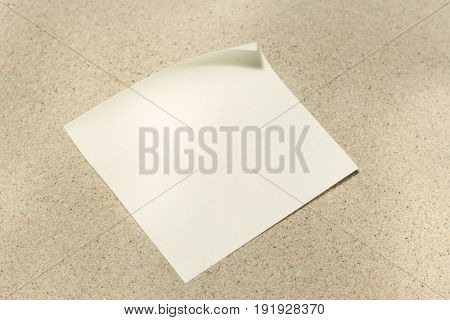 The blank paper message on sand background