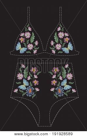 Satin stitch embroidery design with flowers and butterflies. Folk line floral trendy pattern for swimsuit, bra, bikini, clothing. Natural fashionable ornament for clothes on black background